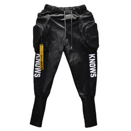 Bolsillo grande online-Primavera verano Hip hop Joggers Cargo pantalones harem hombres Bolsillos grandes Cremalleras Blanco Negro