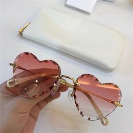 designer em forma de coração óculos de sol Desconto New fashion designer mulheres óculos de sol em forma de coração sem moldura com lentes de corte de luz clara lente de cor clara óculos ultra-leves 150