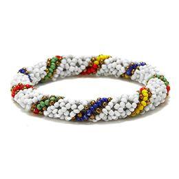 I modelli dei braccialetti dei branelli online-Nepal Handmade Bead Bracelet Hippy Amicizia Popolare Roll Crochet Perline di seme tessuto Perline strisce colorate per le donne