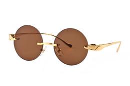 Tête des lunettes de soleil en Ligne-Carter alliage marque célèbre lentilles claires rondes longue bouche tête léopard métal jambe cadre doré lunettes de soleil en corne de buffle avec logo boîte rouge boîtier