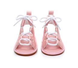 Zapatos de vestir princesa online-Nueva llegada suela de goma dura verano romana niñas niños zapatos de gladiador bebé niño princesa vestido de cuero con cordones sandalias 0-24 M