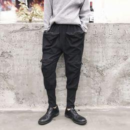 Hombres Streetwear Hip Hop Pantalón Harem Casual Multi bolsillo Negro Japón  Cargo Pantalones Hombre Punk Joggers pantalones punk harem baratos 581aa95e070