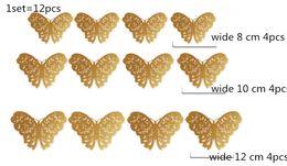 Mariposas plateadas para decoracion online-Oro plata 12 unids / set 3D PVC Pegatinas de Pared Mariposas Hollow DIY Home Decor Poster Habitaciones Decoración de La Pared Del Banquete de Boda