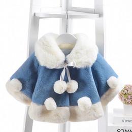 Ropa de invierno para bebés online-Ropa de niñas Chaqueta de invierno Nueva hembra de bebé engrosamiento Poncho Piel de conejo de imitación Cabo Moda Infantil Camisa de capa