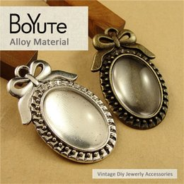 Wholesale Filigree Cabochon Settings - BoYuTe (40 Pieces Lot) 25*18MM Antique Bronze Silver Plated Filigree Bowknot Cameo Cabochon Base Setting Pendant Jewelry Blank Accessories
