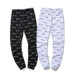 hommes coréens pantalons blancs Promotion Automne Nouvelle mode coréenne hommes Pantalon de survêtement pour hommes pantalons en vrac sarouel cordon noir noir Joggers