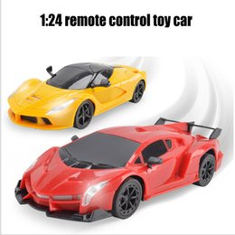 Wholesale Toys Electric Motor Car - 1:24 electric four remote control car with headlights toy car wholesale gifts gifts puzzle child car model