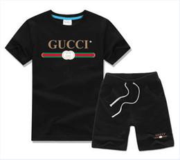 2-7 años de edad, niño viejo Juegos para niños Camiseta y pantalón de algodón para niños Bebé Niños Niñas Traje de verano Bebé Traje deportivo 2 Unids Set GG551 desde fabricantes