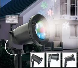 Proyector de copo de nieve en movimiento Proyector LED para interiores / exteriores Luz de copo de nieve que se mueve automáticamente RGB Color Nieve Láser Luz para el césped Fiesta desde fabricantes