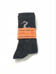 Argentina 17FW Heron Preston Cranes Calcetines de baloncesto bordado Harajuku Monopatín de algodón Hip Hop High Street Sports Calcetines de media altura Suministro