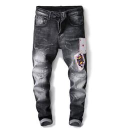 2018 conception originale nouvelle européenne et américaine mode hommes noir chat à gratter doit être brodé poker insigne élastique hommes jeans lavage ? partir de fabricateur