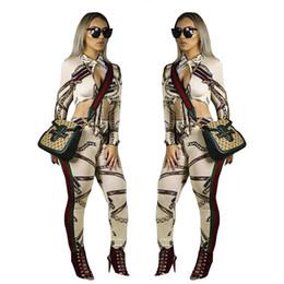 Pantalones de cuerpo sexy online-Moda sexy estampado floral mujeres conjunto de dos piezas patchwork mangas largas tops de cultivos + raya pantalones casuales traje 2PCS conjuntos Bodycon Body