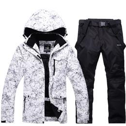 2019 calças de esqui de mulher -30 branco adulto mulheres e homens roupas de esqui conjuntos de snowboard à prova d 'água à prova de vento à prova d' água respirável ao ar livre paletó e calça cinto Unsex desconto calças de esqui de mulher