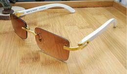 Casi di legno di lusso online-2018 occhiali da sole firmati di lusso in corno di bufalo occhiali da sole firmati per uomo donna occhiali da sole in legno di bambù rettangolo senza montatura con scatoloni scatoloni