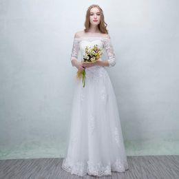 Off Shoulder Tulle A Line Vestido de novia 2019 Apliques de encaje Vestidos de novia modernos Mangas 3/4 desde fabricantes