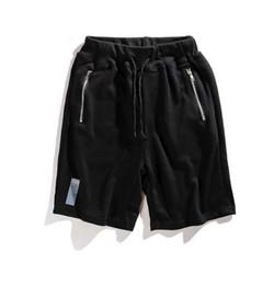 Tubo del cordón de los hombres online-2018 verano nuevos hombres de encaje de algodón, pantalones de tubo recto de gran tamaño, letra amarilla que imprime cinco pantalones.