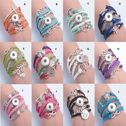 Boutons de couleur multicolores en Ligne-Noosa Chunks Ginger Snap Multilayer Bracelet Multicolore Charms Infinity Leather Button Bracelet Déclaration de bijoux pour les femmes