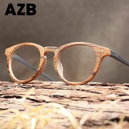 e7e7ab2d3ea AZB Haute qualité Vintage verres clairs Lunettes oeil de chat en bois  lunettes hommes lecture ordinateur montures lunettes pour femmes