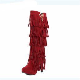 Argentina Zapatos de invierno para mujer Botas para mujer de gamuza sintética sobre borlas Rodilla Botas cálidas y cómodas Muslo Botas altas supplier womens flat tassel boots Suministro