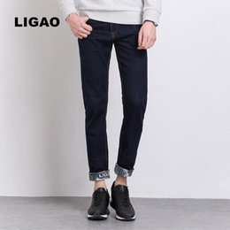 LIGAO Men s Jeans 2017 Patched Red Ear Denim Pants Fashion Design Color  Blocking Men Denim Jeans Cuffs Print Straight Slim Male 72e0b7e32