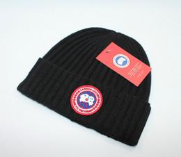 cappello di lana dell'orecchio del gatto nero Sconti 2020 Canada Marca BEANIE uomini cappello a maglia teschio sport classici tappi donne casuali Berretti GOOSE all'aperto
