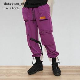 Calças de calças on-line-Homens / Mulheres Fivela Correias Carga Calças 2018 Hip Hop Multi Bolsos Baggy Harem Calças Basculador Masculino Casual Streetwear Calças