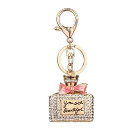 llavero de perfume Rebajas 2017 botellas de perfume de la aleación del diamante de imitación encanto chispeante bolso del llavero bolso llavero llave colgante del coche ag03
