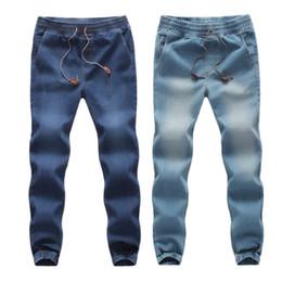 Pantaloni che lavorano uomini online-Pantaloni casual da uomo FeiTong da uomo Casual Autunno Autunno in cotone elasticizzato a righe String Pantaloni da lavoro Pantaloni jeans