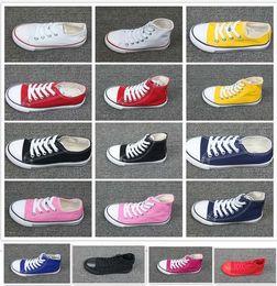 f3f690d7d3ab2 2019 chaussures enfants 24 Nouvelle Marque Enfants Bébé Chaussures De Toile  De Mode Haute Basse Enfants