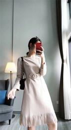 4a54d9492d4379 2018 Herbst und Winter neue Muster koreanische Mode Temperament sieben Teil  Ärmel Quasten Rock Deerskin Down Kleid Y11115