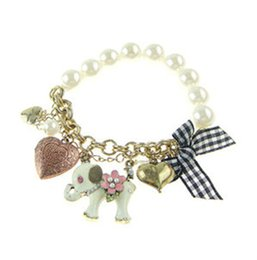 white resin elephants Coupons - Korean version new pearl jewelry elephant peach bow multi element lattice retro Bracelet