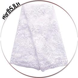 Telas de novia de encaje blanco para Tela melocotón Partes africanos bordado Guipure cordón de tela africana del cordón 2018 de la alta calidad desde fabricantes