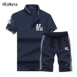 trajes entallados para hombre azul marino Rebajas 2 piezas + pantalones cortos de chándal conjunto de hombres Casual SportSuit chándal de corte slim fit azul oscuro para hombre ropa de manga corta Sportwear
