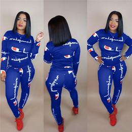 корейский летний костюм оптом Скидка Женщины чемпионов письмо спортивный костюм с длинным рукавом футболка + брюки леггинсы 2 шт. Бегунов комплект балахон наряды спортивная одежда спортивный костюм S-3XL