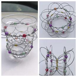 Wholesale puzzles tricks - Metal Ring Puzzle magic flower basket Magic Trick Iron Gadget Anti Stress Adult magic ring toy changeable flower blanket KKA4854