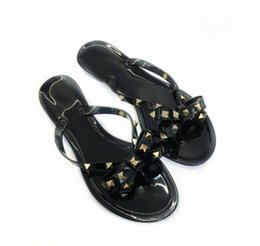 Wholesale christmas thongs - European style bow flip flops Fashion women rivets flat shoes 34-40 size Jelly slippers summer thong sandals beach shoes+logo+box