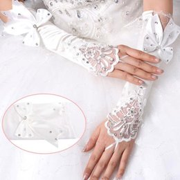 Wholesale stocking bows - 5.6$ In Stock 2018 White Ivory Beaded Bow Lace Fingerless Wedding Bridal Gloves Prom Evening Cocktail Gloves for Bride CPA243