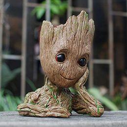 2019 vasi da giardino di approvvigionamento all'ingrosso Moda Guardiani di The Galaxy Flowerpot Baby Groot Action Figures Cute Model Toy Pen Pot Migliori regali di Natale per i bambini Raccogliere giocattoli