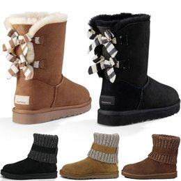 Piel de bota negra online-Diseñador al por mayor de invierno cálido esponjoso Bailey TALL piel suela de goma piel de vaca baja botas de nieve de piel para hombres negro gris al aire libre zapatos casuales
