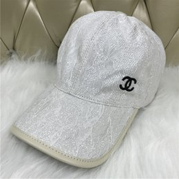 2018 new hats Fashion men s and women s canvas baseball caps hats Black and  white embroidery badges Outdoor leisure sun hats 1245cbb79d6a