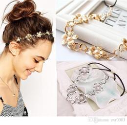 Moda mujer cabeza de metal flor del pelo venda del pelo banda elástica venda de moda para las mujeres accesorios para el cabello desde fabricantes
