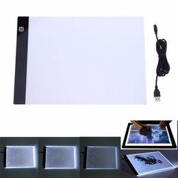 Tableaux de table en Ligne-Tablette graphique LED Écriture Peinture Boîte à lumière Planche de traçage Tablette de copie Tableaux numériques Tablette Artcraft A4 Tableau de copie Tableau LED