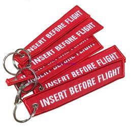 Canada 30 PCS / LOT Bijoux de mode Porte-clés pour Motos OEM Porte-clés Broderie Rouge Porte-clés INSERT AVANT VOL Étiquettes pour porte-clés Offre