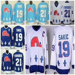 Camisetas de hockey sobre hielo de los hombres de los niños Quebec Nordiques Sakic 19 Jersey de coser CCM de Joe Sakic Dark Blue Light White desde fabricantes