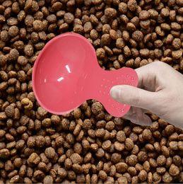 Argentina Suministros para mascotas comida pala Alta calidad varios colores de caramelo comida Forma de corazón linda cuchara para mascotas perro pequeño cachorro pala de comida supplier heart shaped spoons Suministro
