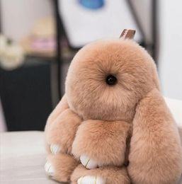 Argentina 2018Fashion 15CM Rex Fluffy Rabbit Keychain Colgante Charm Bunny Keychain Mujeres Real de piel de conejo llaveros Pom Toy Doll joyería colgante Suministro