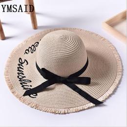 Ymsaid Wide Brim Sun Hats For Women Letter Embroidery Black Bow Panama  Straw Hat Folded Floppy Beach Ladies Caps Chapeu Feminino S18101708 c932ce4eedb4