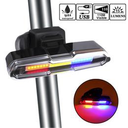 Luces de advertencia online-USB recargable LED bicicleta luz trasera con 3 colores de luz y 6 modos de iluminación Multiusos Super brillante bicicleta luz de advertencia para montar