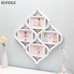Wholesale Family Wall Picture Frames - SUFEILE 1PC Rhombus Combination Frame 4 photos frame Plastic material Family Bedroom decoration Picture on wall SI3D5