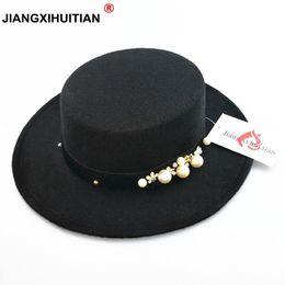 581762cb295c0 2017 nueva perla chapeau femme Vintage de moda negro top fieltro sombrero  fedora hombres sombrero bowler trilby sombreros para mujeres